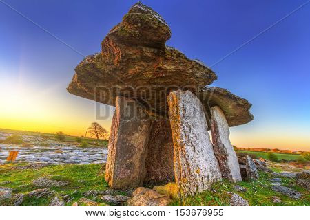 Poulnabrone portal tomb in Burren at sunrise, Ireland