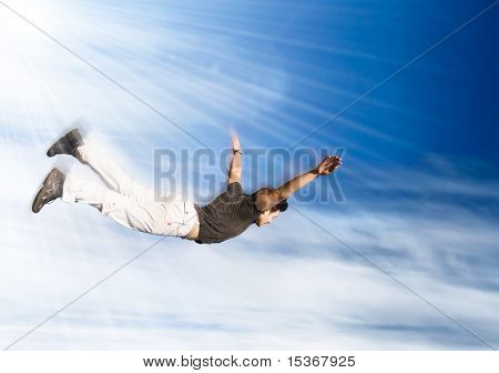Flying man. Young man falling down on sky background.