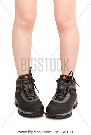 Awkward woman in big male boots. Isolated on white.