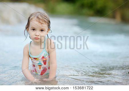Adorable Child Having Fun On A Beach