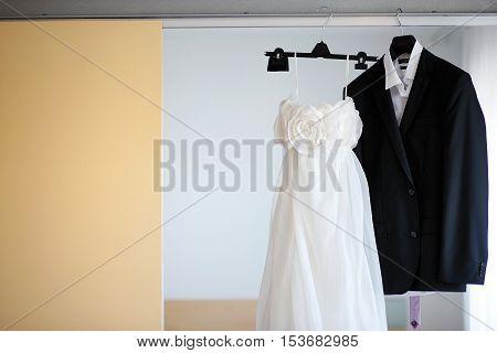 Wedding Dress And A Tuxedo Hanging