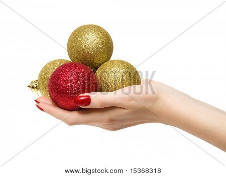 Woman hand with new year balls. Isolated on white.