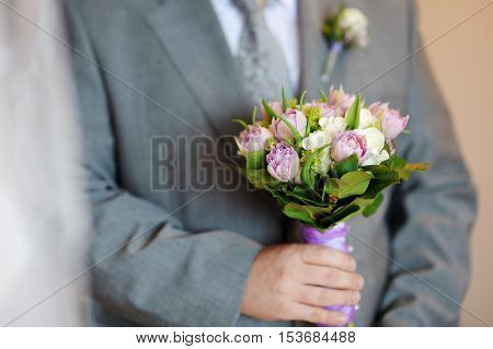Groom Holding Flowers