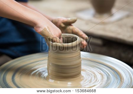 Hand of young man potter in the act of making product