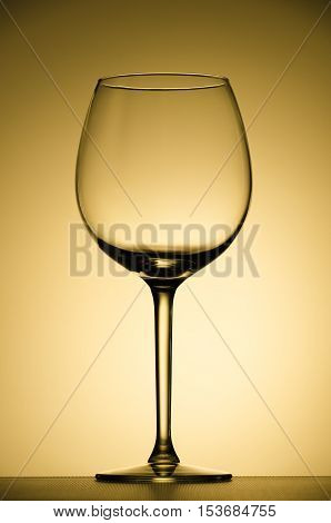wine glass on a highlighted background. gradient background