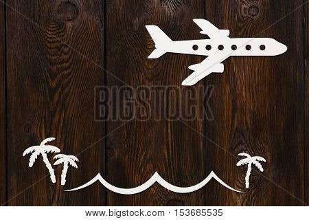 Paper flying plane. Abstract conceptual image with copy space. Dark wooden background