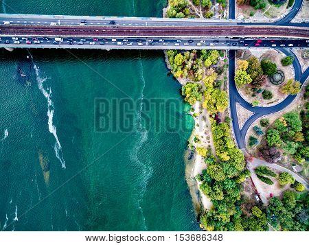 Kyiv roads with bridge across Dnipro, Ukraine, top view, aerial photo