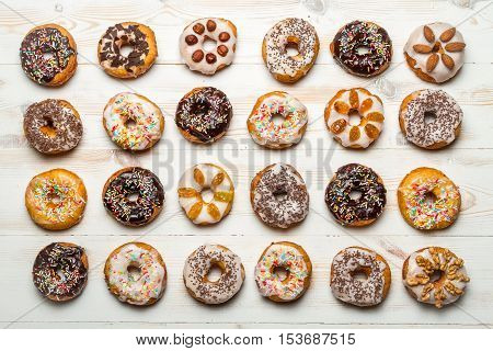 Closeup of large group of colorfully decorated donuts