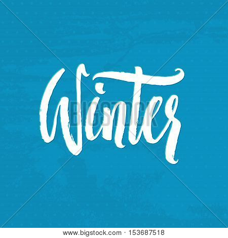 Winter. Hand Drawn Calligraphy on Blue background. Winter handlettering inscription. Winter logos and emblems for invitation, greeting card, t-shirt, prints and posters.
