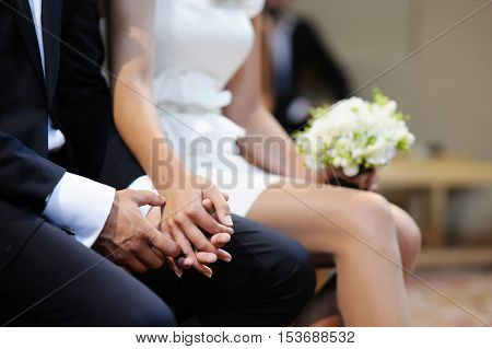 Bride And Groom Holding Hands On The Wedding