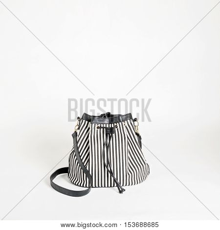 Fashion accessories - black-and-white striped bag. Selective focus.