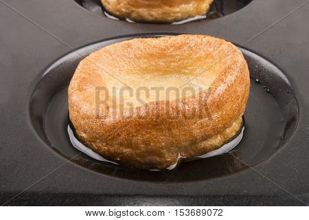freshly baked yorkshire pudding with sunflower oil in a baking tray