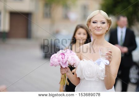 Beautiful young bride portrait outdoors on summer day