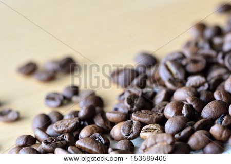 Roasted Coffee Beans On A Wooden Background
