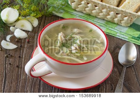 Chicken And Pasta Soup With Parsley On A Dark Wooden Background.