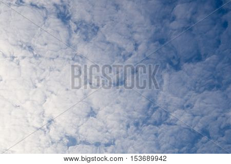 white clouds and blue sky in background. Clouds.