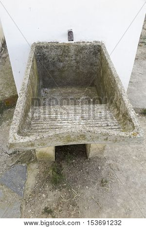 picture foreground of an ancient laundry stone