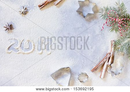 Christmas Branch And Ingredients For Christmas Baking - Spices, Flour, Powdered Sugar And Shape Cook