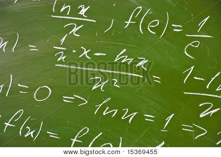 Math formulas on school blackboard.