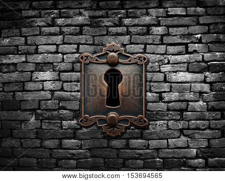 Old fashioned metal lock on a brick wall