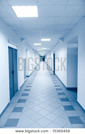 Long corridor in scientific laboratory. Bright blue tint.