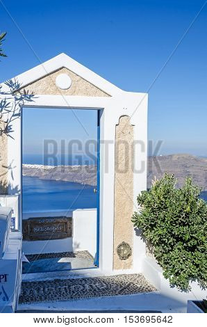 Structure characteristic of Santorini architecture - the doorway that goes to nowhere and serves to frame the Aegean Sea.Thira Greece.