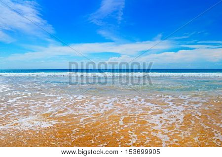 tropical ocean, sandy beach and blue sky