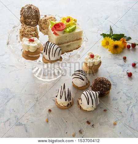 Different cakes composition on concrete background