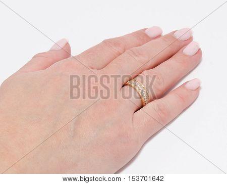 ring on a finger on white background