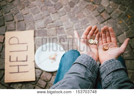 A homeless begging money because poor in the street