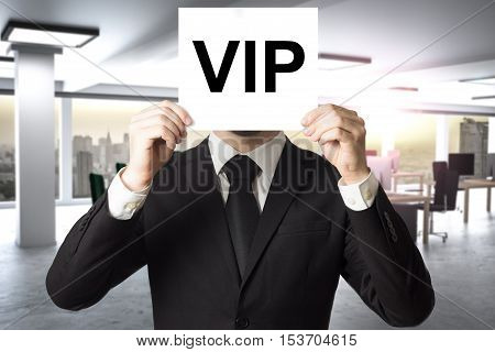 businessman prominence hiding face behind white sign vip