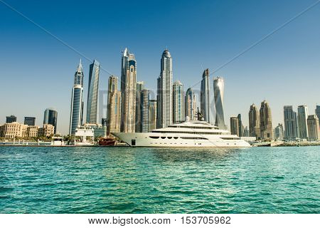 DUBAI, UAE - OCTOBER 09, 2016. View of various skyscrapers in Dubai Marina with stunning turquoise waters as foreground