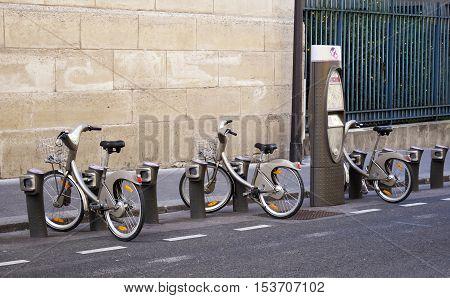 PARIS FRANCE - SEPTEMBER 27 2015: Bicycles parked at Velib station in Paris France