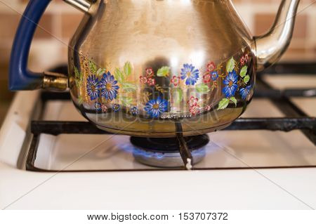 Since the patterned pot on the stove to boil water