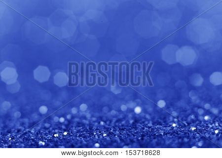 Christmas background. Shiny blue abstract background. Glitter background