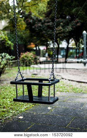 empty swing in the park in autumn