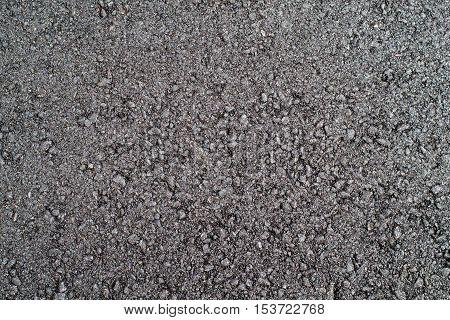 coarse black freshly made compacted asphalt closeup