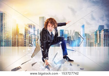 Business man punch with power and determination in the floor of roof