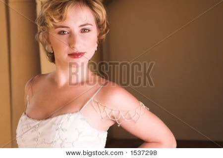 Young Blonde Bride Wearing Wedding Gown