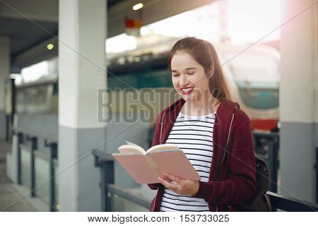Reading at the station