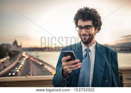 Businessman holding his smartphone