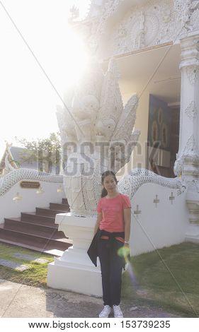 thai woman with Sri Don Moon pagoda in Chiangmai Thailand
