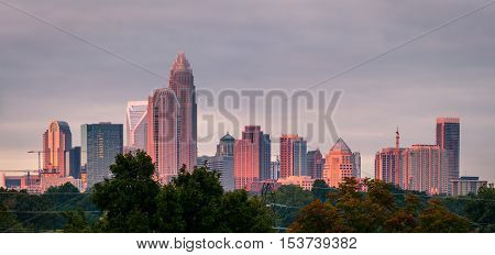 A luminescent and colorful sunrise hitting the buildings that make up the Charlotte, North Carolina skyline.