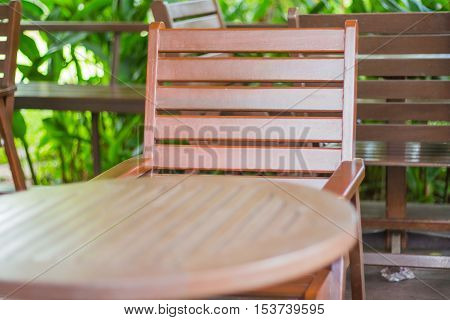 Wooden chairs and coffee table in the garden