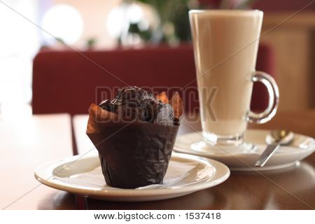 Chocolate Muffin And Coffee Latte On Background