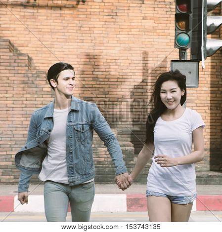 Young couple in love Couple running across the crosswalk