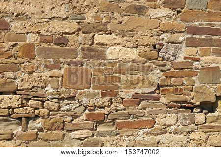 The texture of the wall of an ancient fortress. Architecture exterior background