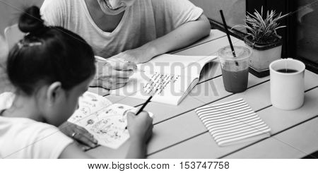 Woman And Girl Doing Homework Concept