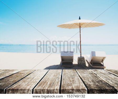 The Beach Holidays, wooden table top on blurred defocus blue sea and white sand beach in sunrise background