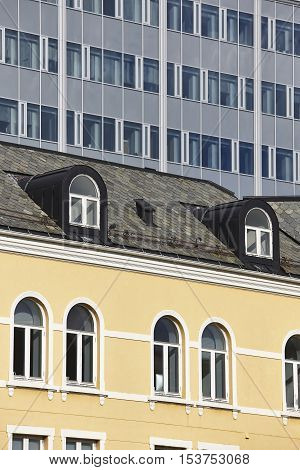 Modern and antique classic buildings facades. Norway. Europe. Vertical